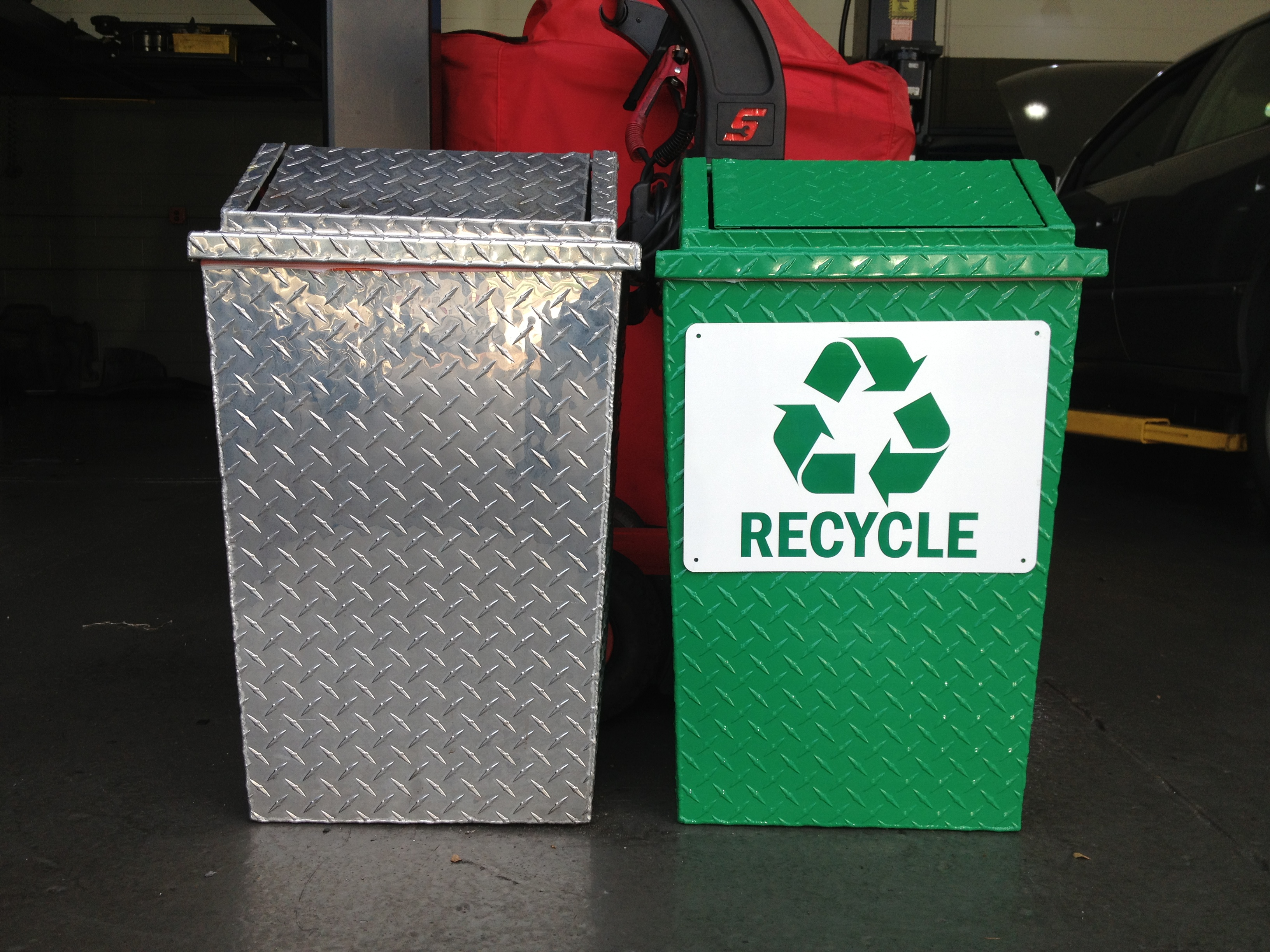 Recycle bin next to trash can
